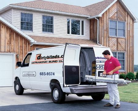 man delivering blinds